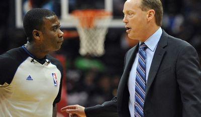 Atlanta Hawks head coach Mike Budenholzer, right, argues a call with referee James Williams in the first half of the NBA basketball game with the Portland Trail Blazers Thursday, March 27, 2014, in Atlanta. (AP Photo/David Tulis)