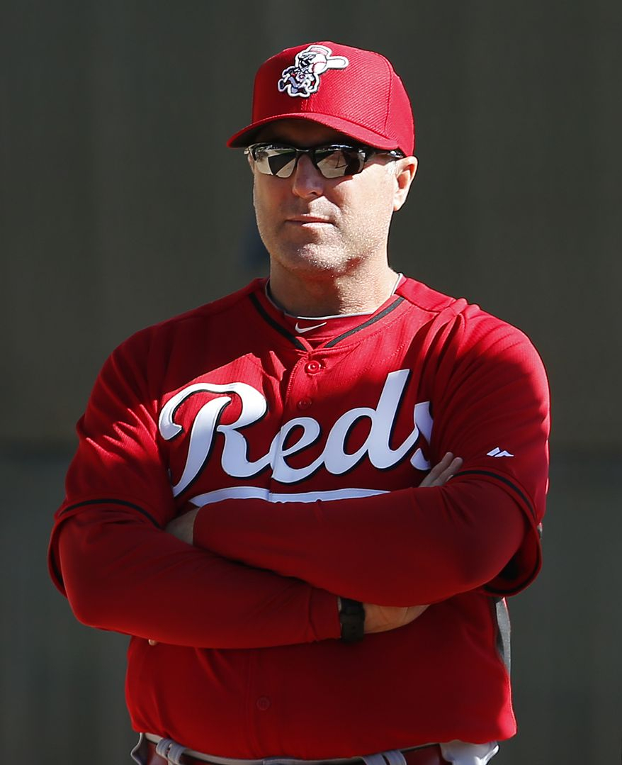 Cincinnati Reds manager Bryan Price watches during spring training baseball practice in Goodyear, Ariz., Saturday, Feb. 15, 2014. (AP Photo/Paul Sancya)
