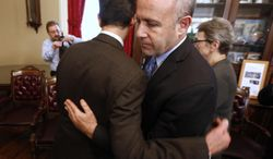 State Senate President Pro Tem Darrell Steinberg, right, D-Sacramento, is consoled by Sen. Mark Leno, D-San Francisco, after Steinberg and fellow Democrats called for Sen. Leland Yee, D-San Francisco, to resign his seat in the wake of his arrest on federal corruption and firearm charges, during a news conference in Sacramento, Calif. Steinberg said lawmakers will immediately suspend Yee unless he steps down. The announcement comes hours after Yee was arrested and appeared in federal court. (AP Photo/Rich Pedroncelli)