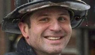 This undated photo released by the Boston Fire Department via Twitter shows firefighter Michael R. Kennedy, killed Wednesday, March 26, 2014, when trapped the basement while fighting a fire in an apartment building in Boston. Kennedy, 33, a Marine Corps combat veteran was assigned to Ladder 15, and had been a firefighter for more than six years. (AP Photo/Boston Fire Department)