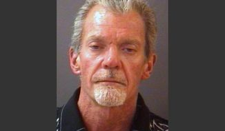 FILE - This file mug shot provided by the Hamilton County Sheriff's Department shows Indianapolis Colts owner Jim Irsay after he was arrested Sunday night, March 16, 2014. Police say Irsay had $29,000 in cash with him when he was arrested last week on suspicion of intoxicated driving.  The Indianapolis Star reports it obtained the Carmel police documents on Irsay's March 16 arrest through a public records request. (AP Photo/Hamilton County Sherriff's Department)