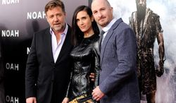 """Actors Russell Crowe, left, and Jennifer Connelly pose with director Darren Aronofsky at the premiere of """"Noah,"""" at the Ziegfeld Theatre on Wednesday, March 26, 2014, in New York. (Photo by Evan Agostini/Invision/AP)"""