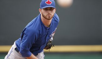 Toronto Blue Jays starting pitcher Drew Hutchison (36) watches his warmup pitch before starting in a spring exhibition baseball game against the Philadelphia Phillies in Clearwater, Fla., Thursday, March 27, 2014. The Blue Jays shutout the Phillies 3-0. (AP Photo/Kathy Willens)