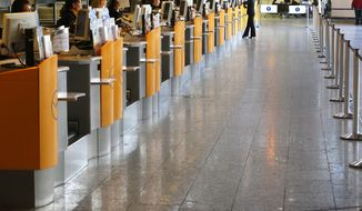 Ticket counters of German Lufthansa airline are empty as public employees of the Frankfurt airport went on a warning strike for higher wages in Frankfurt, Germany, Thursday, March 27, 2014. Lufthansa had to cancel more than 600 flights. (AP Photo/Michael Probst)