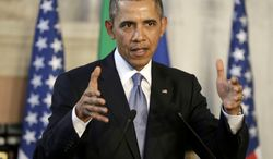 President Barack Obama gestures during a joint news conference with Italian Prime Minister Matteo Renzi, Thursday, March 27, 2014, at Villa Madama in Rome. (AP Photo/Pablo Martinez Monsivais)