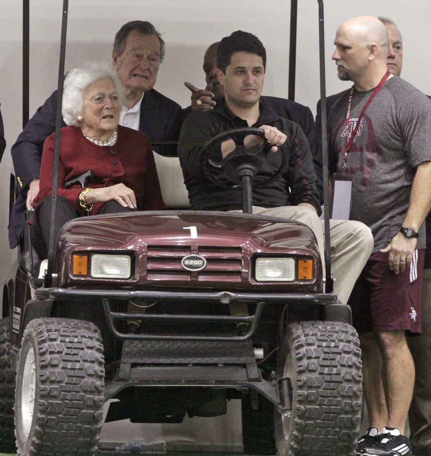 Former President George H.W. Bush and Barbara Bush, left, attend Texas A&M pro day for NFL football representatives in College Station, Texas, Thursday, March 27, 2014. (AP Photo/Patric Schneider)