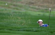 Jordan Spieth hits from a sand trap on the 10th hole during the first round of the Valero Texas Open golf tournament, Thursday, March 27, 2014, in San Antonio. Play was delayed for more than two hours Thursday due to rain and fog. (AP Photo/Eric Gay)