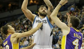 Minnesota Timberwolves center Nikola Pekovic, center, of Montenegro, shoots against Los Angeles Lakers guard Steve Nash (10) and forward Ryan Kelly (4) during the first quarter of an NBA basketball game in Minneapolis, Friday, March 28, 2014. (AP Photo/Ann Heisenfelt)