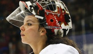 FILe - In this Feb. 17, 2014 file photo, goalkeeper Shannon Szabados of Canada skates off the ice after the second period of the 2014 Winter Olympics women's semifinal ice hockey game against Switzerland at Shayba Arena in Sochi, Russia. After winning gold with the Canadian Olympic women's hockey team, Szabados signed on with a men's minor league team in Georgia. What she and other gifted athletes really need is more leagues of their own. (AP Photo/Petr David Josek, File)
