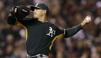 Oakland Athletics pitcher Scott Kazmir throws against the San Francisco Giants during the third inning of an exhibition baseball game in San Francisco, Thursday, March 27, 2014. (AP Photo/Jeff Chiu)
