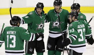 Dallas Stars' Ray Whitney (13), Jamie Benn, Alex Goligoski (33) and Tyler Seguin (91) celebrate with Alex Chiasson (12) following Chiasson's goal in the second period of an NHL hockey game against the Nashville Predators, Friday, March 28, 2014, in Dallas. (AP Photo/Tony Gutierrez)