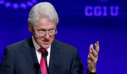 Former president Bill Clinton speaks at a student conference for the Clinton Global Initiative University at Arizona State University, in this March 21, 2014, file photo taken in Tempe, Ariz. (AP Photo/Ross D. Franklin, File)