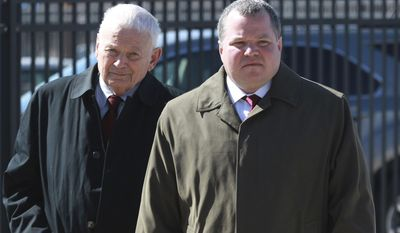 FILE - In this Feb. 26, 2014 file photo, former St. Clair County Judge Michael Cook, right, arrives at the U.S. District Courthouse in East St. Louis, Ill., with his father, Bruce Cook. Michael Cook, who is at the center of a courthouse drug scandal, is to appear Friday morning, March 28, 2014, for a scheduled sentencing at federal court in East St. Louis. Cook resigned last year after being accused of heroin possession and illegally having a firearm. (AP Photo/Belleville News-Democrat, Derik Holtmann, File)