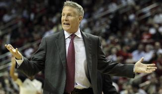 Philadelphia 76ers head coach Brett Brown questions an official's call during the second half of an NBA basketball game against the Houston Rockets, Thursday, March 27, 2014, in Houston. Houston won 120-98. (AP Photo/Bob Levey)