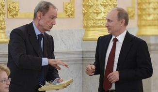 Russian President Vladimir Putin, right, listens to Chairman of the IOC Coordination Commission for Sochi 2014 Jean-Claude Killy during a Council of Physical Fitness and Sports in the Kremlin in Moscow, Russia, Monday, March 24, 2014. (AP Photo/RIA-Novosti, Alexei Nikolsky, Presidential Press Service)