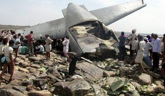Indian villagers crowd around the debris of an Indian air force cargo plane that crashed near Karauli village in the central Indian state of Madhya Pradesh, Friday, March 28, 2014. C-130J Hercules plane inducted into service just last year crashed during a training mission Friday, killing all five crew members in the latest in a series of accidents that have hit the Indian armed forces. (AP Photo)
