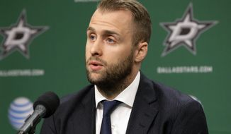 Dallas Stars center Rich Peverley responds to questions during a news conference before the Stars' NHL hockey game against the Nashville Predators, Friday, March 28, 2014, in Dallas. Peverley collapsed on the bench during a game earlier this month. He then had surgery to correct an abnormal heart rhythm. (AP Photo/Tony Gutierrez)