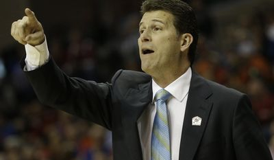 UCLA head coach Steve Alford speaks to players during the first half in a regional semifinal game against the Florida at the NCAA college basketball tournament, Thursday, March 27, 2014, in Memphis, Tenn. (AP Photo/Mark Humphrey)