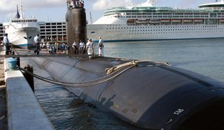 In this April 26, 2004, file photo provided by the U.S. Navy, the USS Miami SSN 755, homeported in Groton, Conn., arrives in port in Fort Lauderdale, Fla. (AP Photo/U.S. Navy, PH2 Kevin Langford, files)