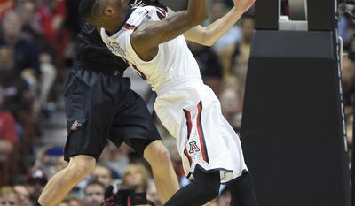San Diego State forward Matt Shrigley, rear, blocks a shot by Arizona forward Rondae Hollis-Jefferson during the second half in a regional semifinal of the NCAA men's college basketball tournament, Thursday, March 27, 2014, in Anaheim, Calif. (AP Photo/Mark J. Terrill)