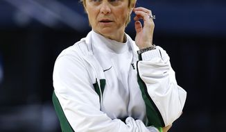 Baylor head coach Kim Mulkey watches NCAA women's college basketball tournament practice at the Purcell Pavilion in South Bend, Ind., Friday, March 28, 2014. Baylor plays Kentucky in a regional semifinal on Saturday. (AP Photo/Paul Sancya)