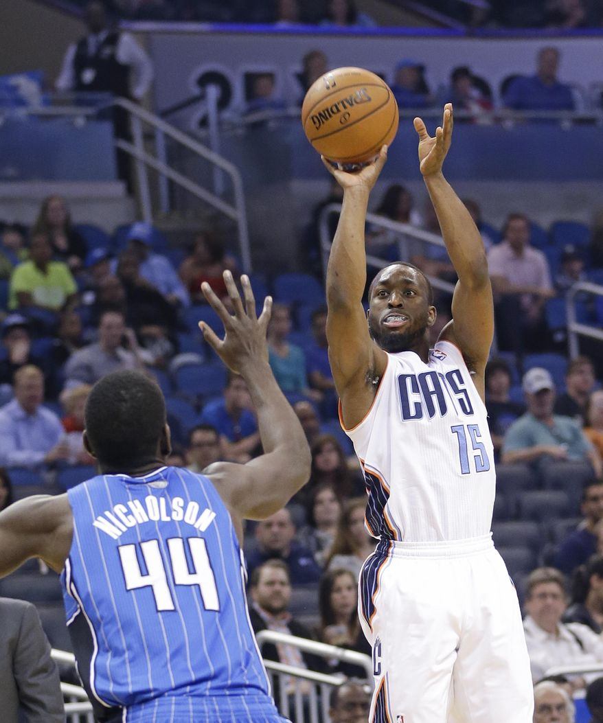 Charlotte Bobcats' Kemba Walker (15) takes a shot over Orlando Magic's Andrew Nicholson (44) during the first half of an NBA basketball game in Orlando, Fla., Friday, March 28, 2014. (AP Photo/John Raoux)