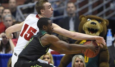 Wisconsin forward Sam Dekker (15) and Baylor guard Kenny Chery reach the ball during the first half of an NCAA men's college basketball tournament regional semifinal, Thursday, March 27, 2014, in Anaheim, Calif. (AP Photo/Mark J. Terrill)
