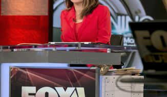 """FILE - This Feb. 24, 2014 file photo shows Maria Bartiromo during the debut of her """"Opening Bell with Maria Bartiromo""""  program on the Fox Business Network, in New York. Bartiromo debuts her one-hour program, """"Sunday Morning Futures,"""" at 10 a.m. ET. It will feature interviews with business leaders and roundtable discussions, with an emphasis on anticipating the financial stories of the upcoming week. (AP Photo/Richard Drew, File)"""