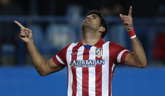 Atletico's Diego Costa celebrates his goal during a Spanish La Liga soccer match between Atletico Madrid and Granada at the Vicente Calderon stadium in Madrid, Spain, Wednesday, March 26, 2014. (AP Photo/Andres Kudacki)