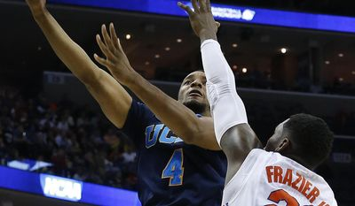 UCLA guard Norman Powell (4) shoots against Florida guard Michael Frazier II (20) during the second half in a regional semifinal game at the NCAA college basketball tournament, Thursday, March 27, 2014, in Memphis, Tenn. (AP Photo/Mark Humphrey)