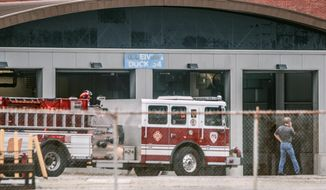 Fire and rescue crews were called to the Rolls Royce plant in Indianapolis on Friday March 28, 2014 after an explosion involving an acid vat. Eight workers were transported to area hospitals in stable condition. The plant remains evacuated, and second shift has been cancelled. (AP Photo/The Indianapolis Star, Michelle Pemberton)  NO SALES