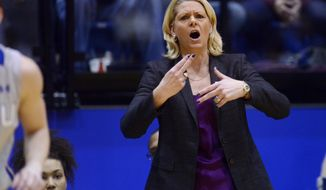 Minnesota head coach, Pam Borton leads her team as they play South Dakota State in Thursday's 3rd round WNIT basketball game at Frost Arena in Brookings, S.D. March 27, 2014. SDSU beat Minnesota 70-62.(AP Photo/Argus Leader, Elisha Page) NO SALES