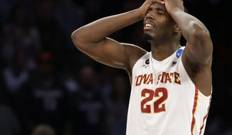 Iowa State's Dustin Hogue reacts to Iowa State's 81-76 loss to Connecticut in a regional semifinal of the NCAA men's college basketball tournament Friday, March 28, 2014, in New York. (AP Photo/Seth Wenig)