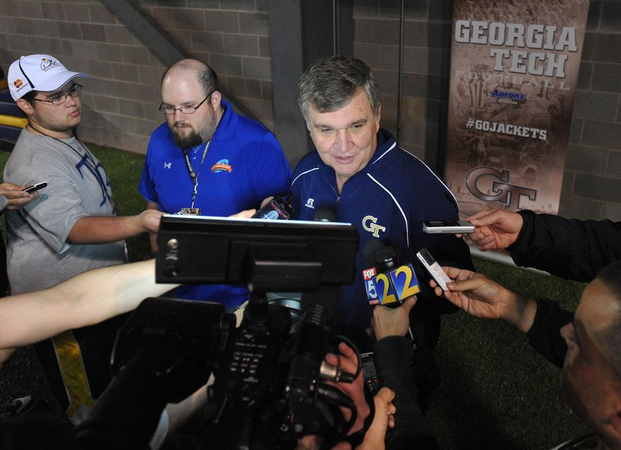 Georgia Tech NCAA college football head coach Paul Johnson answers questions about his players during their NFL pro day Friday, March 28, 2014, in Atlanta. (AP Photo/David Tulis)
