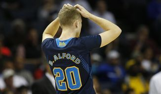 UCLA guard Bryce Alford (20) walks on the court during the second half in a regional semifinal game against Florida at the NCAA college basketball tournament, Thursday, March 27, 2014, in Memphis, Tenn. (AP Photo/John Bazemore)