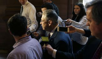 Assembly Speaker Sheldon Silver, D-Manhattan, talks to reporters in a hallway at the Capitol on Friday, March 28, 2014, in Albany, N.Y. (AP Photo/Mike Groll)