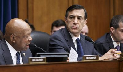 House Oversight Committee Chairman Rep. Darrell Issa, R-Calif., right, listens as the committee's ranking member, Rep. Elijah Cummings, D-Md. speaks on Capitol Hill in Washington, Wednesday, March 26, 2014, as the committee continues its probe of whether tea party groups were improperly targeted for increased scrutiny by the Internal Revenue Service. (AP Photo/J. Scott Applewhite)