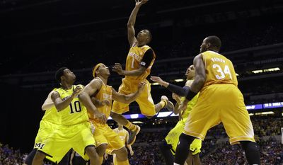 Tennessee's Josh Richardson (1) shoots during the second half of an NCAA Midwest Regional semifinal college basketball tournament game against the Michigan Friday, March 28, 2014, in Indianapolis. (AP Photo/David J. Phillip)
