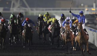 African Story from Britain, front right, ridden by Silvestre De Sousa, crosses the finish line to win the world's richest horse race Dubai World Cup at Meydan racecourse in Dubai, United Arab Emirates, Saturday, March 29, 2014. (AP Photo/Kamran Jebreili)