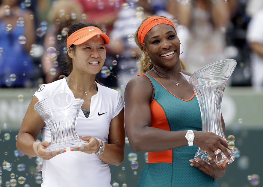 Serena Williams, right, of the United States, and Li Na, of China, pose for photos after the trophy presentation for the women's final at the Sony Open Tennis tournament in Key Biscayne, Fla., Saturday, March 29, 2014. Williams won 7-5, 6-1. (AP Photo/Alan Diaz)