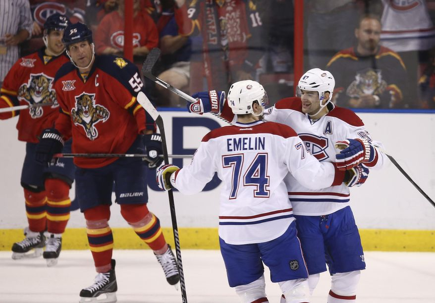 Montreal Canadiens' Alexei Emelin (74) and Max Pacioretty (67) celebrate after a goal as Florida Panthers' Ed Jocanovski (55) watches during the first period of an NHL hockey game in Sunrise, Fla., Saturday, March 29, 2014. (AP Photo/J Pat Carter)