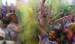Revelers throw colored corn starch in the air while celebrating during the 2014 Festival of Colors, Holi Celebration at the Krishna Temple Saturday, March 29, 2014, in Spanish Fork, Utah. Nearly 70,000 people are expected to gather starting Saturday at a Sri Sri Radha Krishna Temple in Spanish Fork for the annual two-day festival of colors. Revelers gyrate to music and partake in yoga during the all-day festival, throwing colored corn starch in the air once every hour. The Salt Lake Tribune reports that the large majority of participants are not Hindus, but Mormons. Thousands of students from nearby Brigham Young University come to take part in a festival that is drug and alcohol free. The event stems from a Hindu tradition celebrating the end of winter and the triumph of good over evil. (AP Photo/Rick Bowmer)