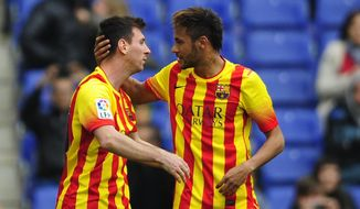 FC Barcelona's Lionel Messi, left, celebrates after scoring a penalty with his teammate Neymar during a Spanish La Liga soccer match against Espanyol at Cornella-El Prat stadium in Cornella Llobregat, Spain, Saturday, March 29, 2014. (AP Photo/Manu Fernandez)