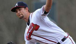 Atlanta Braves starting pitcher Mike Minor delivers during the first inning of an exhibition baseball game against the team's minor league Future Stars Saturday, March 29, 2014, in Rome, Ga. (AP Photo/David Tulis)