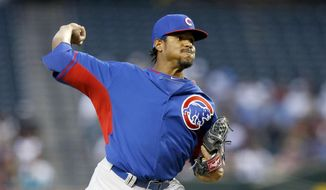 Chicago Cubs' Edwin Jackson throws a pitch against the Arizona Diamondbacks during the first inning of an exhibition baseball game, Friday, March 28, 2014, in Phoenix. (AP Photo/Ross D. Franklin)