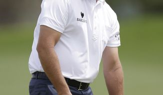 Phil Mickelson reacts as he misses an eagle putt on the 14th hole during the third round of the Texas Open golf tournament on Saturday, March 29, 2014, in San Antonio. Mickelson withdrew from the tournament with a pulled muscle. (AP Photo/Eric Gay)