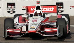 Juan Pablo Montoya, of Colombia, drives into turn 10 during practice for the IndyCar Firestone Grand Prix of St. Petersburg auto race Saturday, March 29, 2014, in St. Petersburg, Fla. The race takes place on Sunday. (AP Photo/Chris O'Meara)