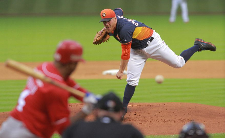 Houston Astros pitcher Brett Oberholtzer throws to Rojos del Aguila de Veracruz's Enrique Osorio during the first inning in a spring exhibition baseball game on Saturday, March 29, 2014, in Houston.(AP Photo/Richard Carson)
