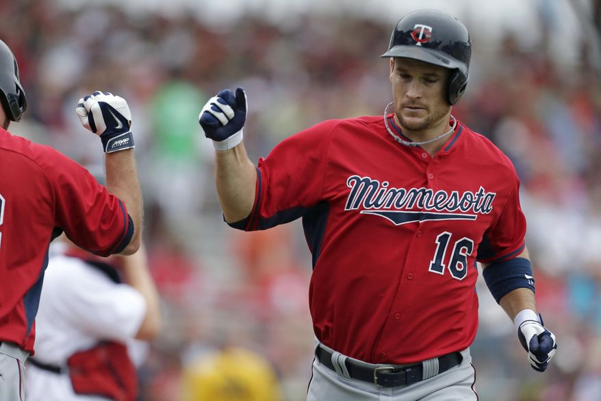Minnesota Twins' Josh Willingham (16) is greeted by Jason Kubel after hitting a solo home run during the second inning of an exhibition baseball game against the Boston Red Sox in Fort Myers, Fla., Saturday, March 29, 2014. (AP Photo/Gerald Herbert)