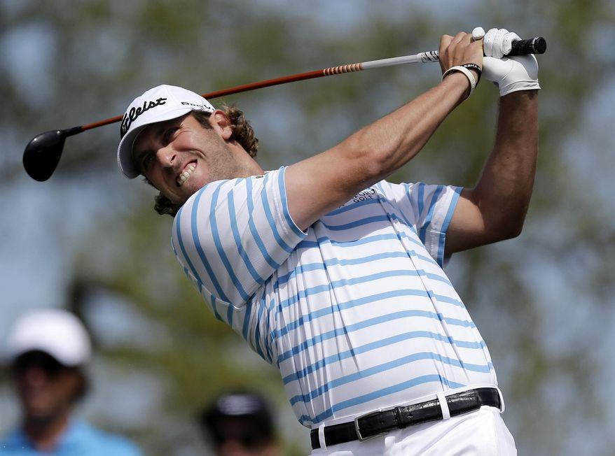 Andrew Loupe hits his tee shot on the second hole during the third round of the Texas Open golf tournament, Saturday, March 29, 2014, in San Antonio. (AP Photo/Eric Gay)
